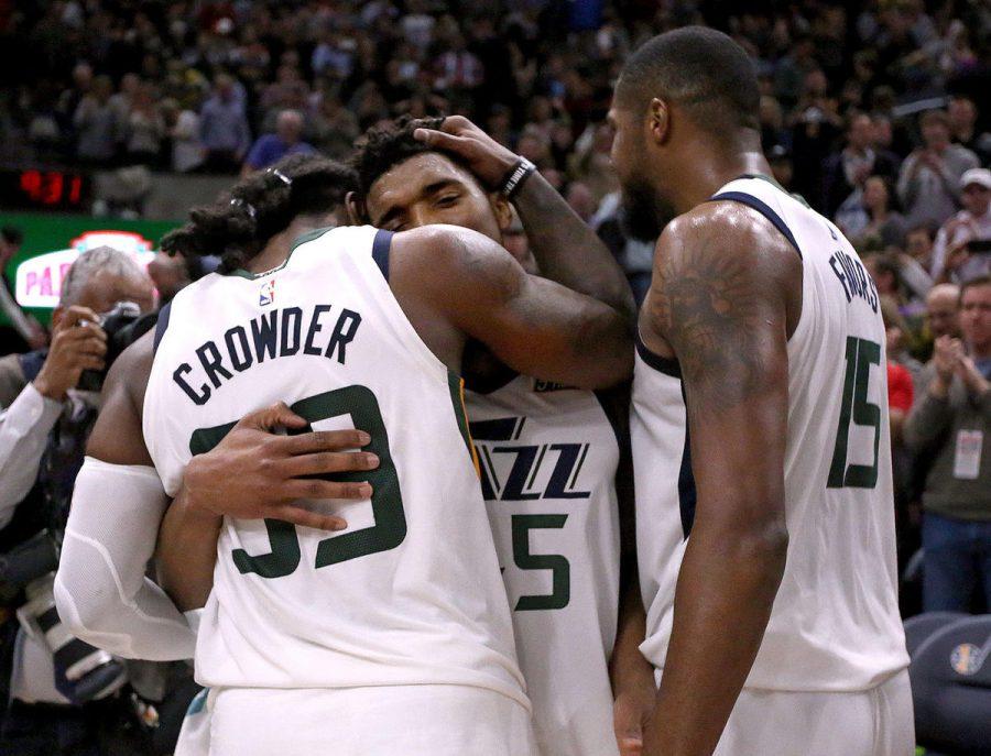 New Jazz man Jae Crowder #99 hugs new teammates following a win